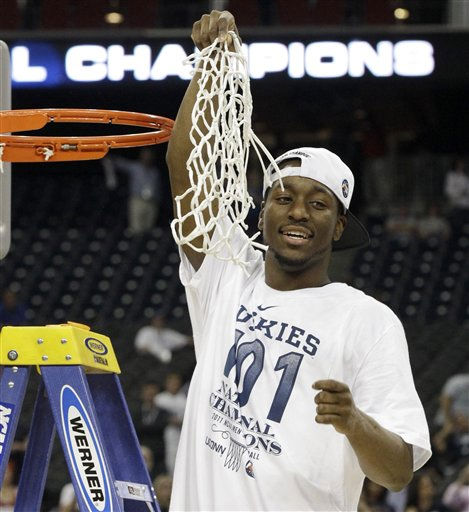 Connecticut&#39;s Kemba Walker holds the net after his team won the men&#39;s NCAA Final Four college basketball championship game against Butler  53-41 Monday, April 4, 2011, in Houston. &#40;AP Photo&#47;David J. Phillip&#41; <span class=meta>(AP Photo&#47; David J. Phillip)</span>