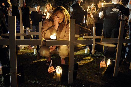 Jami Cash, daughter of dead coal miner Michael Elswick, attends a vigil following the Upper Big Branch Memorial Service, Tuesday, April 5, 2011, in Whitesville, W.Va. The memorial was for the 29 coal miners who were killed in an explosion at the mine one year ago in Montcoal, W.Va. &#40;AP Photo&#47;Jeff Gentner&#41; <span class=meta>(AP Photo&#47; Jeff Gentner)</span>