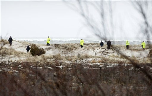 FILE -  In this April 5, 2011 file photo, emergency personnel search the dunes and scrub near the ocean, across the road from where eight bodies where found, near Oak Beach, N.Y.  While investigators scour miles of desolate New York beachfront and map plans for officers to traverse a daunting morass of thicket on horseback in search of more victims, dozens of detectives are inspecting credit card receipts, telephone records, old traffic tickets and even applications for clamming licenses in the hunt for a possible serial killer. &#40;AP Photo&#47;Seth Wenig, File&#41; <span class=meta>(AP Photo&#47; Seth Wenig)</span>