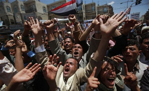 Anti-government protestors shout slogans during a demonstration demanding the resignation of Yemeni President Ali Abdullah Saleh, in Sanaa, Yemen, Wednesday, April 6, 2011. Defying a deadly government crackdown, tens of thousands of protesters have poured into the streets of a city in southern Yemen in ongoing protests against longtime president Ali Abdullah Saleh. &#40;AP Photo&#47;Muhammed Muheisen&#41; <span class=meta>(AP Photo&#47; Muhammed Muheisen)</span>