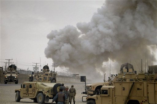 "<div class=""meta ""><span class=""caption-text "">Smoke billows from a police compound after it was attacked by insurgents in Kandahar, south of Kabul, Afghanistan on Thursday, April 7, 2011. Insurgent suicide bombers and gunmen stormed an Afghan police compound Thursday, setting off explosions and firing assault rifles in a coordinated attack that killed six members of the Afghan security forces.(AP Photo/Khalid Sial) (AP Photo/ Khalid Sial)</span></div>"