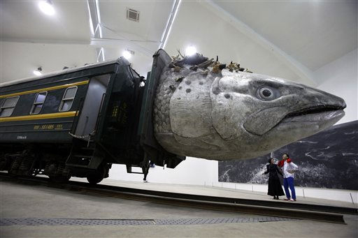 An installation art work entitled &#34;Leviathanation&#34; by Huang Yongping features a giant fish head made from fiberglass, stuffed animals and a train is displayed at a gallery in Beijing, China, Thursday, April 7, 2011. &#40;AP Photo&#47;Ng Han Guan&#41; <span class=meta>(AP Photo&#47; Ng Han Guan)</span>