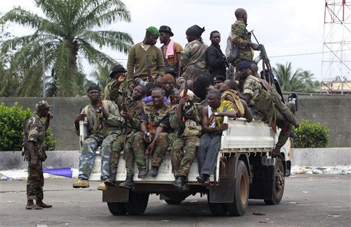 "<div class=""meta image-caption""><div class=""origin-logo origin-image ""><span></span></div><span class=""caption-text"">Soldiers loyal to Alassane Ouattara, along with several men who were detained for unknown reasons, drive past  a checkpoint serving as an operating base, at one of the main entrances to Abidjan, Ivory Coast, Thursday, April 7, 2011. French forces wearing night vision goggles rappelled from a helicopter to rescue the Japanese ambassador and seven others, France's foreign minister said Thursday, as Ivory Coast's strongman leader remained in an underground bunker amid the fighting. (AP Photo/Rebecca Blackwell) (AP Photo/ Rebecca Blackwell)</span></div>"