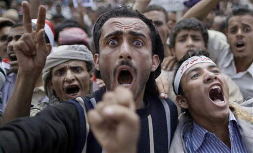 Anti-government protestors shout slogans during a demonstration demanding the resignation of Yemeni President Ali Abdullah Saleh, in Sanaa,Yemen, Thursday, April 7, 2011. Defying a deadly government crackdown, tens of thousands of protesters on Wednesday poured into the streets of Yemen&#39;s second largest city in the latest demonstrations against the long serving president. Arabic on headband at right reads: &#34;We are standing by till you leave&#34;. &#40;AP Photo&#47;Muhammed Muheisen&#41; <span class=meta>(AP Photo&#47; Muhammed Muheisen)</span>