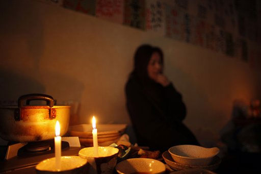 "<div class=""meta image-caption""><div class=""origin-logo origin-image ""><span></span></div><span class=""caption-text"">A patron relaxes after dinner in a local restaurant, where diners ate by candlelight because there was no electricity, in Ichinoseki, Iwate Prefecture, northern Japan Friday, April 8, 2011. A big aftershock rocked quake-weary Japan late Thursday, rattling nerves as it knocked out power to the northern part of the country and prompted tsunami warnings that were later canceled.(AP Photo/Vincent Yu) (AP Photo/ Vincent Yu)</span></div>"