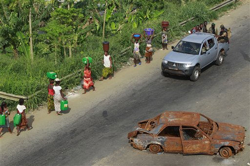 "<div class=""meta ""><span class=""caption-text "">Republican forces soldiers loyal to Alassane Ouattara drive past local residents who ventured out looking for water and supplies, near a republican forces operating base in the Youpougon neighborhood of Abidjan, Ivory Coast, Friday, April 8, 2011. Ivory Coast's democratically elected leader said his forces won't capture the entrenched strongman who remained holed up Friday in an underground bunker at the presidential residence, and instead will focus on normalizing life in the besieged city.(AP Photo/Rebecca Blackwell) (AP Photo/ Rebecca Blackwell)</span></div>"
