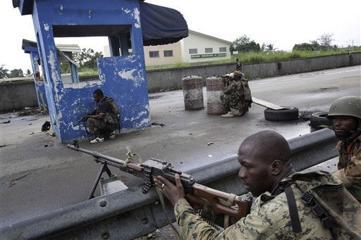 "<div class=""meta ""><span class=""caption-text "">Soldiers allied with Alassane Ouattara take up positions as fighting moves closer to a checkpoint used as a republican forces operating base in the Youpougon neighborhood of Abidjan, Ivory Coast, Sunday, April 10, 2011. Human Rights Watch, in a report obtained by The Associated Press late Saturday, called on Alassane Ouattara to investigate and prosecute abuses by his forces and those supporting his rival, strongman Laurent Gbagbo.   (AP Photo/Rebecca Blackwell) (AP Photo/ Rebecca Blackwell)</span></div>"