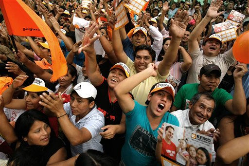 "<div class=""meta ""><span class=""caption-text "">Supporters of presidential candidate Keiko Fujimori, of the political party Fuerza 2011, gather after voting centers closed for general elections in Lima, Peru, Sunday April 10, 2011.  Keiko Fujimori's opponent, candidate Ollanta Humala, is expected to win the most votes in Sunday's presidential elections but fall far short of the outright majority needed to avoid a runoff, making the tight battle for second crucial.  (AP Photo/Karel Navarro) (AP Photo/ Karel Navarro)</span></div>"