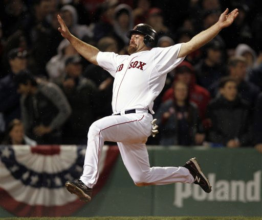 Boston Red Sox&#39;s Kevin Youkilis goes flying into home to score on a double by David Ortiz during the eighth inning of Boston&#39;s 4-0 win over the New York Yankees in a baseball game at Fenway Park in Boston on Sunday, April 10, 2011. &#40;AP Photo&#47;Winslow Townson&#41; <span class=meta>(AP Photo&#47; Winslow Townson)</span>