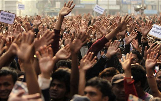 Nepalese citizens wave as they participate in a peace rally to mark the Nepalese New Year in Katmandu, Nepal, Thursday, April, 14, 2011.&#40;AP Photo&#47;Binod Joshi&#41; <span class=meta>(AP Photo&#47; Binod Joshi)</span>