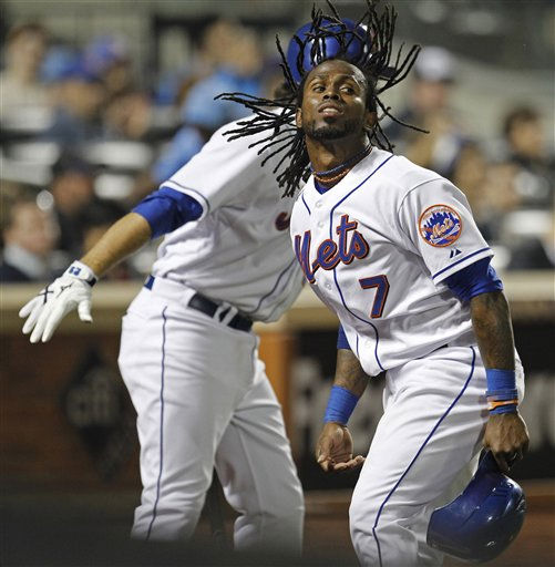 New York Mets Jose Reyes &#40;7&#41; celebrates with on-deck batter Ike Davis after scoring on David Wright&#39;s third-inning sacrifice fly in their baseball game against the Colorado Rockies at Citi Field in New York, Monday, April 11, 2011. &#40;AP Photo&#47;Kathy Willens&#41; <span class=meta>(AP Photo&#47; Kathy Willens)</span>