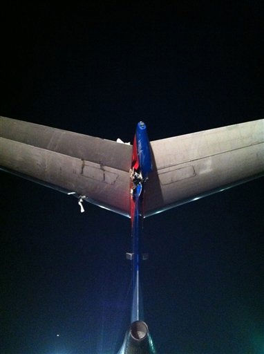 In this image released by the National Transportation Safety Board, a rear angle of  the damage to the rudder and the vertical fin and horizontal tail of the Bombardier CRJ-700 that was damaged when it was clipped by an Air France Airbus A380 at JFK International Airport in New York on Monday, April 11, 2011.  Federal Aviation Administration spokesman Jim Peters says there were no injuries. He says both jets were towed away and will be inspected. &#40;AP Photo&#47;NTSB&#41; <span class=meta>(AP Photo&#47; Anonymous)</span>