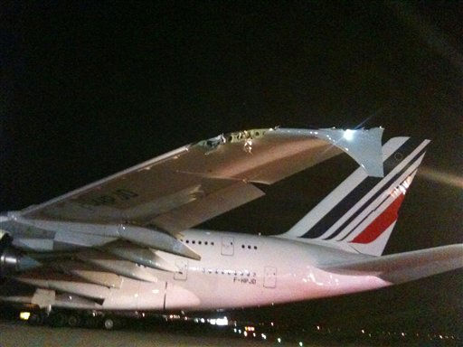 "<div class=""meta ""><span class=""caption-text "">In this image released by the National Transportation Safety Board, the damaged left wing tip of the Air France Airbus A380, is seen after it clipped a Bombardier CRJ700 at JFK Airport in New York on Monday, April 11, 2011.  Federal Aviation Administration spokesman Jim Peters says there were no injuries. He says both jets were towed away and will be inspected. (AP Photo/NTSB) (AP Photo/ Anonymous)</span></div>"