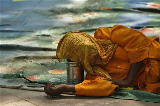 "<div class=""meta ""><span class=""caption-text "">A participant rests during the culmination of 'Save River Yamuna March' in New Delhi, India, Thursday, April 14, 2011. A tributary of one of India's main rivers, the Ganges, the Yamuna is small but swells during monsoon rains. Officials say factories are ignoring regulations and dumping untreated sewage and industrial pollution, turning toxic the river that gives the capital much of its drinking water. (AP Photo/Gurinder Osan) (AP Photo/ Gurinder Osan)</span></div>"