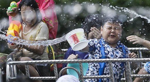 Thais splashe water eachother during New Year celebrations Friday, April 15, 2011 in Bangkok, Thailand.  &#40;AP Photo&#47;David Longstreath&#41; <span class=meta>(AP Photo&#47; David Longstreath)</span>