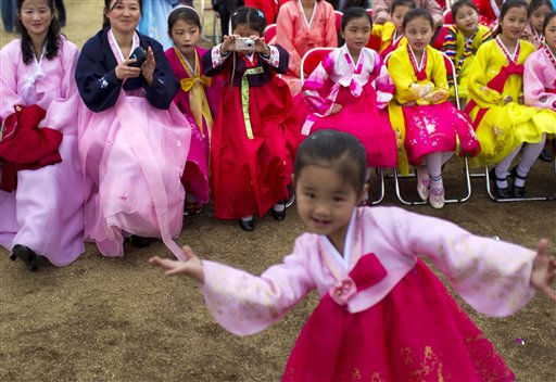 A North Korean girl uses her digital camera to take a photograph of her friend dancing at a gathering at a park to celebrate the 99th anniversary of the late leader Kim Il Sung&#39;s birthday in Pyongyang, North Korea, Friday, April 15, 2011. April 15 is called &#34;The Day of the Sun&#34; in honor of the former guerrilla fighter who founded North Korea in 1948. &#40;AP Photo&#47;David Guttenfelder&#41; <span class=meta>(AP Photo&#47; David Guttenfelder)</span>