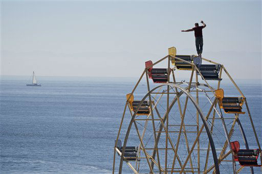 Nik Wallenda practices walking on top of the ferris Wheel at the Santa Cruz Beach Boardwalk, Friday, April 15, 2011 in Santa Cruz, Calif. Wallenda, a seventh generation member of the legendary ?Great Wallendas? circus family, is scheduled to kick off the Santa Cruz Beach Boardwalk?s Spring Break with two jaw dropping stunts on Saturday, April 16, 2011.  &#40;AP Photo&#47;Santa Cruz Beach Boardwalk, Donaven Staab&#41; <span class=meta>(AP Photo&#47; Donaven Staab)</span>