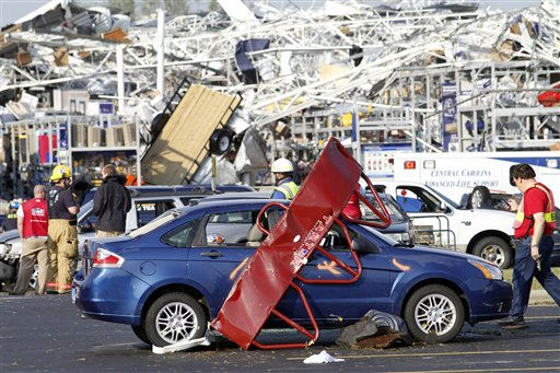 "<div class=""meta ""><span class=""caption-text "">Emergency personnel work around a Lowes Home Improvement store after it was hit by a tornado in Sanford, N.C., Saturday, April 16, 2011. Homes and businesses were badly damaged Saturday by a severe storm system that whipped across North Carolina, bringing flash floods, hail and reports of tornadoes from the western hills to the streets of Raleigh.   In the Lee County town of Sanford, a Lowe's store was smashed by the storm.  ""The Lowe's Home Improvement has been flattened,"" said Monica Elliott, who works at the nearby Brick City Grill. ""It's totally destroyed.""  (AP Photo/Jim R. Bounds) (AP Photo/ Jim R. Bounds)</span></div>"