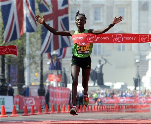 Kenya&#39;s Mary Keitany breaks the tape to win the London Marathon, in London, Sunday April 17, 2011, with Buckingham Palace seen behind. &#40;AP Photo&#47;Tom Hevezi&#41; <span class=meta>(AP Photo&#47; Tom Hevezi)</span>