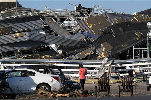 Annina Purdy, who was inside the Lowe&#39;s hardware store in Sanford, N.C. the previous day when a tornado destroyed the building, returned to the store&#39;s parking lot on Sunday, April 17, 2011, to reclaim personal belongings from her car. &#40;AP Photo&#47;Ted Richardson&#41; <span class=meta>(AP Photo&#47; Ted Richardson)</span>
