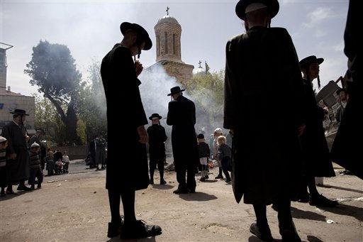 "<div class=""meta ""><span class=""caption-text "">Ultra-Orthodox Jewish men burn leavened items in a final preparation before the Passover holiday, in Jerusalem, Monday, April 18, 2011. All leavened food, such as bread, is forbidden to Jews during the week-long Passover holiday commemorating the Israelites' departure from Egypt. (AP Photo/Oded Balilty) (AP Photo/ Oded Balilty)</span></div>"