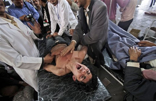 "<div class=""meta ""><span class=""caption-text "">A wounded anti-government protestor, who was injured in clashes with Yemeni security forces on Sunday night, reacts as doctors check on him at a field hospital in Sanaa, Yemen, Monday, April 18, 2011. Security forces fired on anti-government protesters in Yemen's capital Sunday as hundreds of thousands of marchers  including many women packed cities around the country to denounce the president and remarks he made against women taking part in rallies demanding his ouster.  (AP Photo/Muhammed Muheisen) (AP Photo/ Muhammed Muheisen)</span></div>"