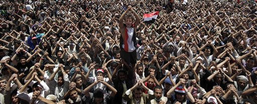 Anti-government protestors gesture while chanting slogans during a demonstration demanding the resignation of  of Yemeni President Ali Abdullah Saleh in Sanaa, Yemen, Tuesday, April 19, 2011. A Yemeni activist said four anti-government protesters have been wounded after security forces opened fire on demonstrators in south Yemen. &#40;AP Photo&#47;Muhammed Muheisen&#41; <span class=meta>(AP Photo&#47; Muhammed Muheisen)</span>
