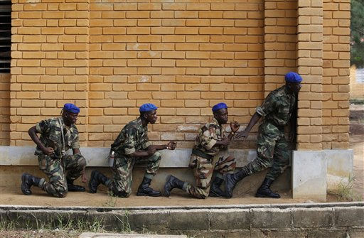 "<div class=""meta ""><span class=""caption-text "">Soldiers from the 'Invisible Commandos,' loyal to Ibrahim Coulibaly, practice ambush techniques without weapons, in the PK-18 area of the Abobo neighborhood, in Abidjan, Ivory Coast Tuesday, April 19, 2011. Commander Hamed Traore says recruits from Abobo have already learned how to use arms, while defending PK-18 against soldiers loyal to strongman Laurent Gbagbo. Now, their training focuses on discipline, respect for hierarchy, and military techniques. Coulibaly on Sunday denied rumors his fighters might challenge the authority of the government installed at the cost of thousands of deaths and injuries. (AP Photo/Rebecca Blackwell) (AP Photo/ Rebecca Blackwell)</span></div>"