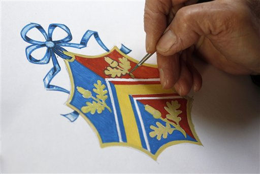 Herald Painter Robert Parsons, sketches the new Coat of Arms for Kate Middleton&#39;s family, at the College of Arms in London, Monday April 18, 2011.  Middleton will only be able to use this Coat of Arms until her wedding to Britain&#39;s Prince William, when it will be merged with his Coat of Arms. Kate&#39;s heraldic design features a tied ribbon to show she is an unmarried woman and the overall shape is an elaborate lozenge - a shield would be used for Middleton men.&#40;AP Photo&#47;Suzanne Plunkett, pool&#41; <span class=meta>(AP Photo&#47; SUZANNE PLUNKETT)</span>