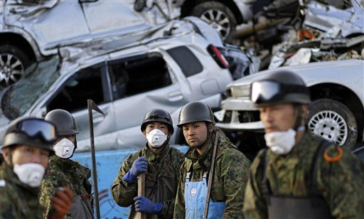 "<div class=""meta ""><span class=""caption-text "">Japan Ground Self-Defense Force members stand in front of the destroyed cars in the area devastated by the March 11 earthquake and tsunami in the port town of Kesennuma, Iwate Prefecture, Japan, Wednesday, April 20, 2011. (AP Photo/Sergey Ponomarev) (AP Photo/ Sergey Ponomarev)</span></div>"