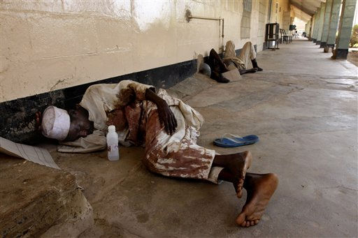 "<div class=""meta image-caption""><div class=""origin-logo origin-image ""><span></span></div><span class=""caption-text"">A victim of postelection violence lies in a corridor as he waits for treatment at St. Gerard's Hospital in Kaduna, Nigeria, Wednesday, April 20, 2011. More than 200 people have been brought to St. Gerard's Hospital, and at least 20 have died. In the hospital's morgue lay the bodies of victims shot, burned and in one case disemboweled in rioting that swept Kaduna in the aftermath of Saturday's presidential vote. (AP Photo/Sunday Alamba) (AP Photo/ Sunday Alamba)</span></div>"