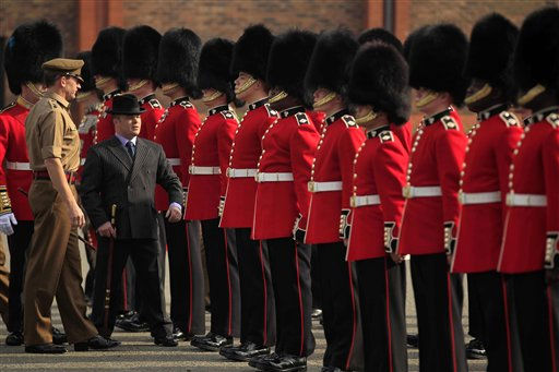 Master Tailor Lance Sergeant Matthew Else, in suit, takes part in a ceremonial inspection ahead of the royal wedding for members of the 1st Battalion Irish Guards at their barracks in Windsor, England, Thursday, April 21, 2011. Britain&#39;s Prince William is due to marry Kate Middleton on April 29.  &#40;AP Photo&#47;Matt Dunham&#41; <span class=meta>(AP Photo&#47; Matt Dunham)</span>