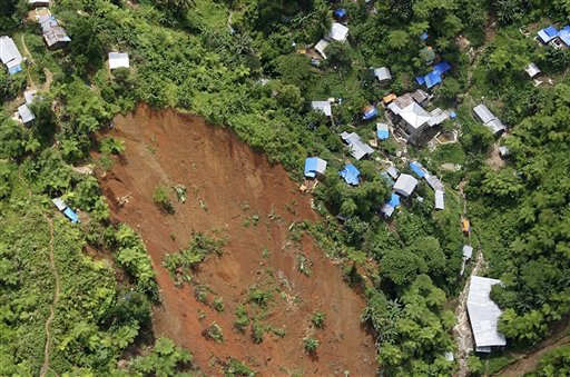 This photo released by Philippine Army shows the extent of a landslide at a mining camp of Compostela Valley on Mindanao region in southern Philippines, Friday, April 22, 2011. The landslide tore through the remote mining camp, killing three people and leaving dozens more missing as it buried shanties, tents and the entrances to illegal mine shafts. &#40;AP Photo&#47;Philippine Army&#41; NO SALES, EDITORIAL USE ONLY <span class=meta>(AP Photo&#47; Anonymous)</span>