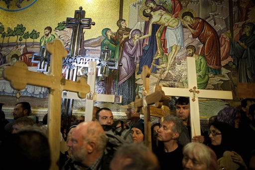 "<div class=""meta ""><span class=""caption-text "">Worshippers carry wooden crosses at the Church of the Holy Sepulchre during the Good Friday procession and the Way of the Cross, in Jerusalem's Old City, Friday, April 22, 2011. Christian pilgrims from around the world filled the narrow cobblestone streets of Jerusalem's Old City on Good Friday, some carrying large wooden crosses as they followed the route Jesus took on the way to his crucifixion. (AP Photo/Oded Balilty) (AP Photo/ Oded Balilty)</span></div>"