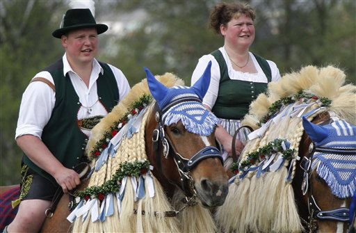 Men and women of the region in traditional dresses ride through fields to get a blessing for men and beasts at the St. George church near Traunstein, southern Germany, on Monday, April 25, 2011. The procession has been held since 300 years on Easter Monday. &#40;AP Photo&#47;Matthias Schrader&#41; <span class=meta>(AP Photo&#47; Matthias Schrader)</span>