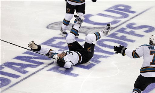 San Jose Sharks center Joe Thornton celebrates after scoring the winning goal against the Los Angeles Kings during overtime of Game 6 of a first-round NHL Stanley Cup playoff hockey series in Los Angeles, Monday, April 25, 2011. &#40;AP Photo&#47;Chris Carlson&#41; <span class=meta>(AP Photo&#47; Chris Carlson)</span>