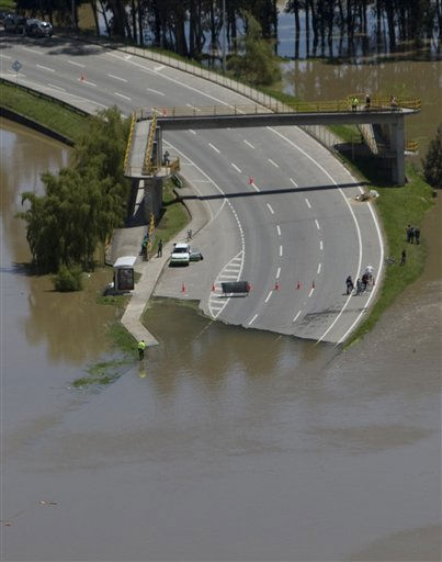 A highway ramp is partially flooded in Chia, on the northern outskirts of Bogota, Colombia, Tuesday April 26, 2011. According to Colombia&#39;s Red Cross officials more than 90 people have died due to flooding and landslides caused by heavy rains since January. &#40;AP Photo&#47;William Fernando Martinez&#41; <span class=meta>(AP Photo&#47; William Fernando Martinez)</span>