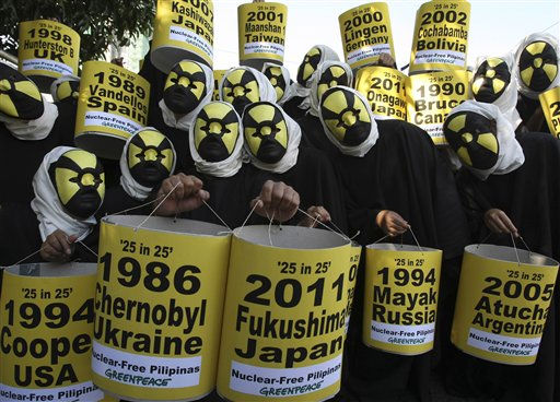 "<div class=""meta ""><span class=""caption-text "">Activists from the environmentalist group Greenpeace, wearing cloaks and masks, display 25 lanterns to highlight 25 of the world's alleged worst nuclear disasters, during a protest at the Department of Energy at suburban Taguig city, south of Manila, Philippines, to mark the 25th anniversary of the Chernobyl nuclear disaster Tuesday April 26, 2011. The activists are calling governments all over the world to abandon all plans of developing nuclear power plants especially in the wake of the recent nuclear power crisis in Japan. (AP Photo/Bullit Marquez) (AP Photo/ BULLIT MARQUEZ)</span></div>"