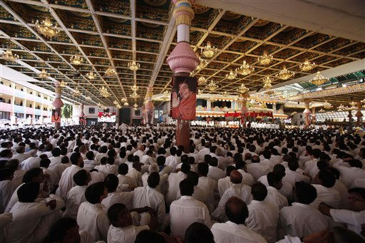 "<div class=""meta image-caption""><div class=""origin-logo origin-image ""><span></span></div><span class=""caption-text"">Volunteers attend the last rites ceremony of Indian religious leader Sathya Sai Baba at the Prasanthi Nilayam Ashram in Puttaparti, India, Wednesday, April 27, 2011. Thousands of tearful devotees, including top politicians, gathered Wednesday for the funeral of Baba, one of India's best-known Hindu ascetics who was revered as a divine incarnation with miraculous healing powers. (AP Photo/Aijaz Rahi) (AP Photo/ Aijaz Rahi)</span></div>"