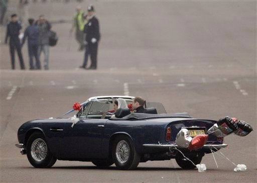 Britain&#39;s Prince William and his wife Kate, Duchess of Cambridge drive away from Buckingham Palace in a convertible after the Royal Wedding in London Friday, April, 29, 2011. &#40;AP Photo&#47;Matt Dunham&#41; <span class=meta>(AP Photo&#47; Matt Dunham)</span>