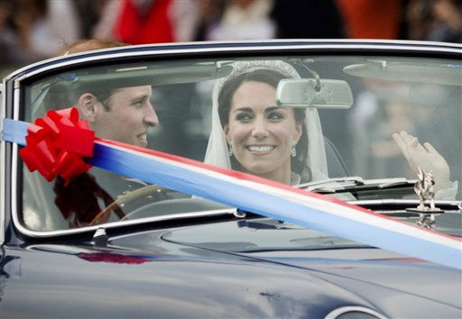 "<div class=""meta ""><span class=""caption-text "">Britain's Prince William drives his wife Kate, Duchess of Cambridge, away from Buckingham Palace in a vintage Aston Martin Volante convertible after their wedding at London's Westminster Abbey, Friday, April, 29, 2011. (AP Photo/Daniel Ochoa de Olza) (AP Photo/ Daniel Ochoa de Olza)</span></div>"