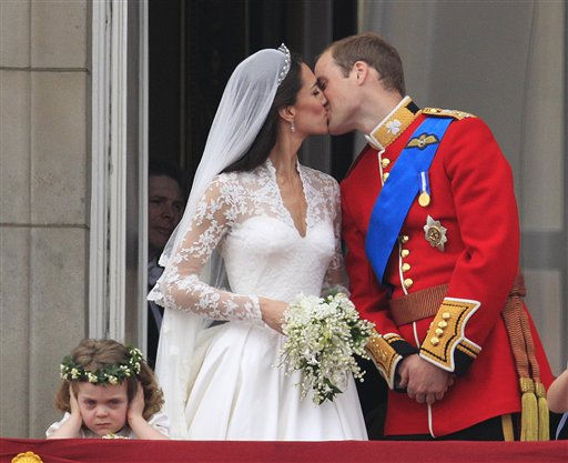 Britain&#39;s Prince William kisses his wife Kate, Duchess of Cambridge on the balcony of Buckingham Palace after the Royal Wedding in London Friday, April, 29, 2011. &#40;AP Photo&#47;Matt Dunham&#41; <span class=meta>(AP Photo&#47; Matt Dunham)</span>