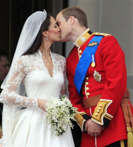 "<div class=""meta image-caption""><div class=""origin-logo origin-image ""><span></span></div><span class=""caption-text"">Britain's Prince William kisses his wife Kate, Duchess of Cambridge on the balcony of Buckingham Palace after the Royal Wedding in London Friday, April, 29, 2011. (AP Photo/Matt Dunham) (AP Photo/ Matt Dunham)</span></div>"