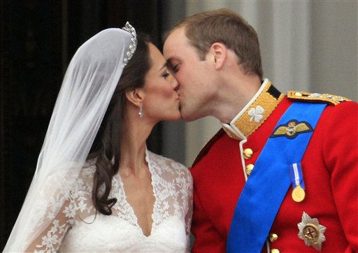 Britain&#39;s Prince William kisses his wife Kate, Duchess of Cambridge, on the balcony of Buckingham Palace after the Royal Wedding in London Friday, April, 29, 2011. &#40;AP Photo&#47;Matt Dunham&#41; <span class=meta>(AP Photo&#47; Matt Dunham)</span>