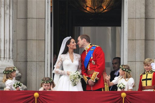 "<div class=""meta ""><span class=""caption-text "">Britain's Prince William kisses his wife Kate, Duchess of Cambridge on from the balcony of Buckingham Palace after the Royal Wedding in London Friday, April, 29, 2011. (AP Photo/Matt Dunham) (AP Photo/ Matt Dunham)</span></div>"