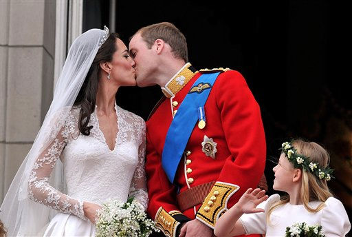 Watched by one of the bridesmaids, Prince William and his wife Kate  Duchess of Cambridge, kiss on the balcony of Buckingham Palace in London,Friday April 29, 2011, following their wedding at Westminster Abbey.&#40;AP Photo&#47;John Stillwell, pool&#41; <span class=meta>(AP Photo&#47; John Stillwell)</span>
