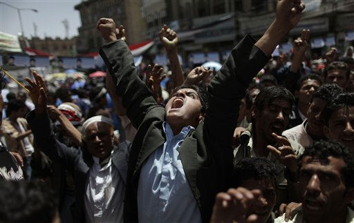 An anti-government protestor reacts during a demonstration demanding the resignation of Yemeni President Ali Abdullah Saleh, in Sanaa,Yemen, Monday, May 2, 2011. &#40;AP Photo&#47;Muhammed Muheisen&#41; <span class=meta>(AP Photo&#47; Muhammed Muheisen)</span>