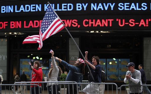 Melissa LaCour, left, Brittany McGarry, second from left, Bryan Murray, second from right, and Dennis Vincent celebrate outside the ABC studio in New York&#39;s Times Square as news of Osama bin Laden&#39;s death is announced on the ticker,  Monday, May 2, 2011.  &#40;AP Photo&#47;Mary Altaffer&#41; <span class=meta>(AP Photo&#47; Mary Altaffer)</span>