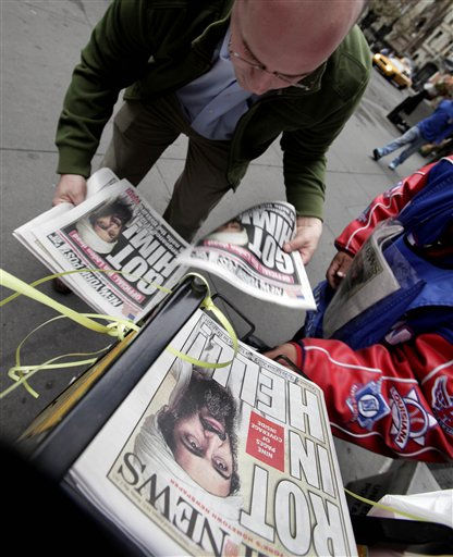 A man buys copies of newspapers in New York&#39;s Financial District featuring headlines of the death of Osama bin Laden, Monday, May 2, 2011. &#40;AP Photo&#47;Richard Drew&#41; <span class=meta>(AP Photo&#47; Richard Drew)</span>