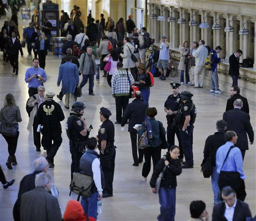 "<div class=""meta ""><span class=""caption-text "">Armed Metropolitan Transportation Authority police officers and city police officer stand among the travelers in New York's Grand Central Station on  Monday, May 2, 2011. Security was heightened as a result of the announcement of the killing of Osama bin Laden. (AP Photo/Stephen Chernin) (AP Photo/ Stephen Chernin)</span></div>"